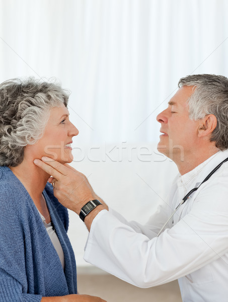 Stock photo: A senior doctor doing an examination of his patient