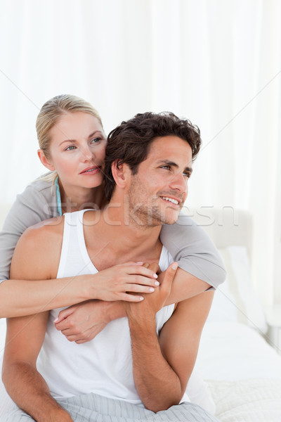 Lovely couple hugging on their bed at home Stock photo © wavebreak_media
