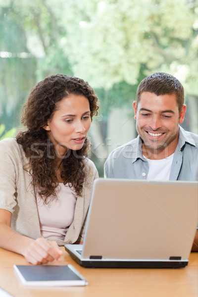 Lovers patrząc laptop domu człowiek szczęśliwy Zdjęcia stock © wavebreak_media