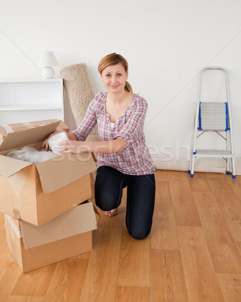 Cute blond-haired woman preparing to move house   Stock photo © wavebreak_media