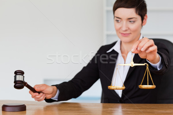 Young judge with a gavel and the justice scale in her office Stock photo © wavebreak_media