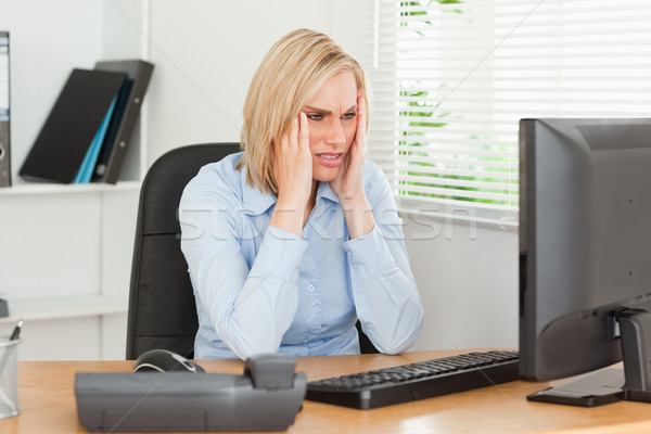Frustrated working woman in front of a screen in an office Stock photo © wavebreak_media
