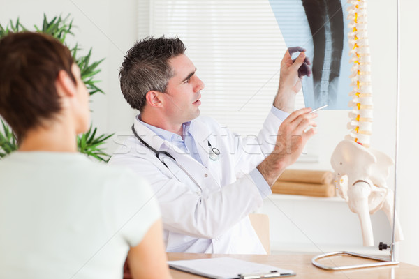 Male Doctor showing a female patient a x-ray in a room Stock photo © wavebreak_media
