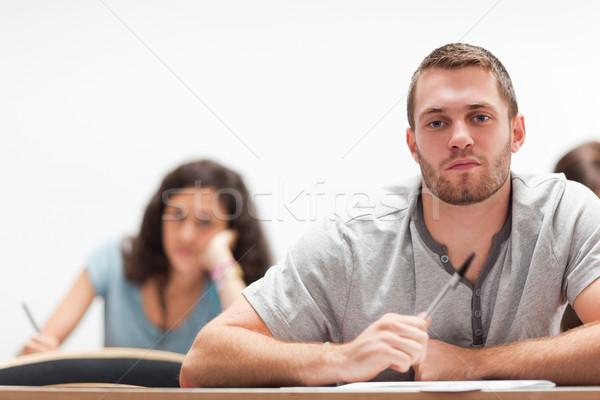 Gülen yakışıklı öğrenci oturma amfitiyatro eğitim Stok fotoğraf © wavebreak_media