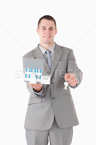 Portret uśmiechnięty biznesmen miniatura domu Zdjęcia stock © wavebreak_media