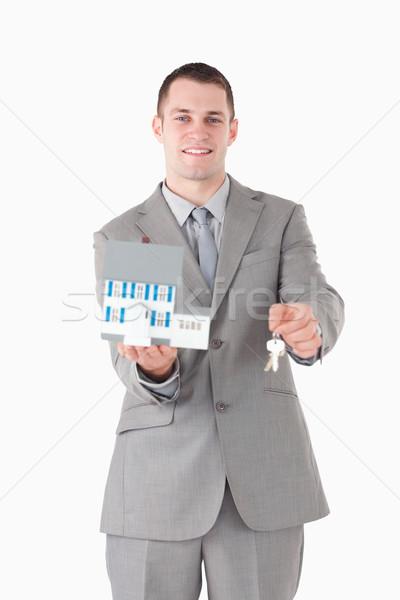 Retrato sorridente empresário miniatura casa Foto stock © wavebreak_media