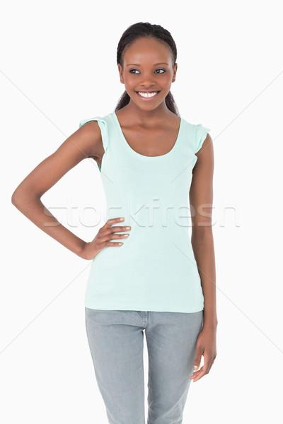 Close up of smiling woman with one arm akimbo on white background Stock photo © wavebreak_media