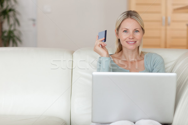 Young woman on the couch booking holidays Stock photo © wavebreak_media