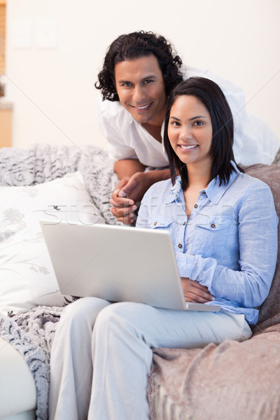 Young couple surfing the internet on the couch Stock photo © wavebreak_media