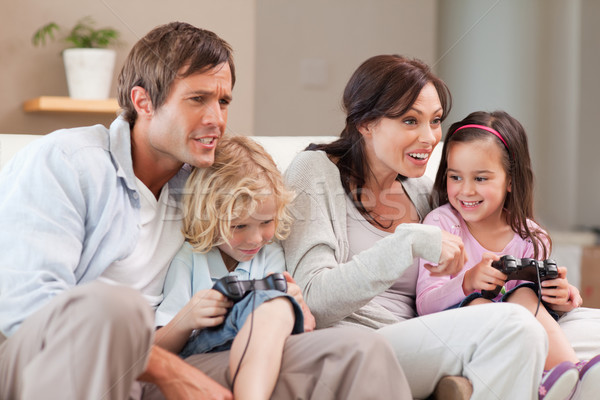 Competitive family playing video games together in a living room Stock photo © wavebreak_media
