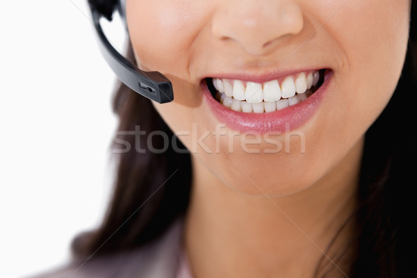 Sorridente empresária fone branco negócio sorrir Foto stock © wavebreak_media
