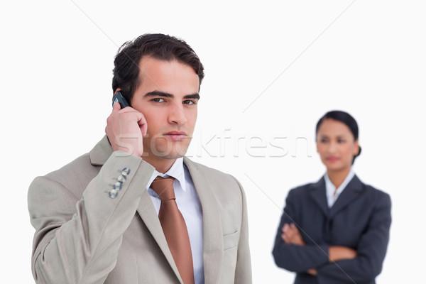 深刻 セールスマン 携帯電話 同僚 後ろ 白 ストックフォト © wavebreak_media