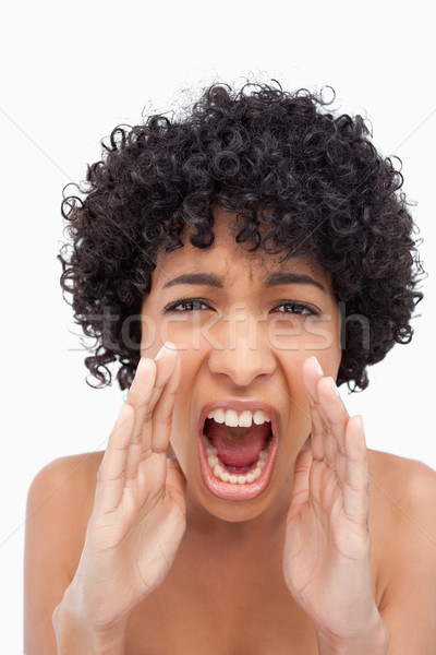 Young woman roaring very loudly against a white background Stock photo © wavebreak_media