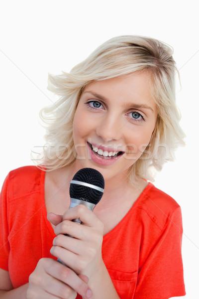 Sonriendo adolescente cantando micrófono blanco Foto stock © wavebreak_media