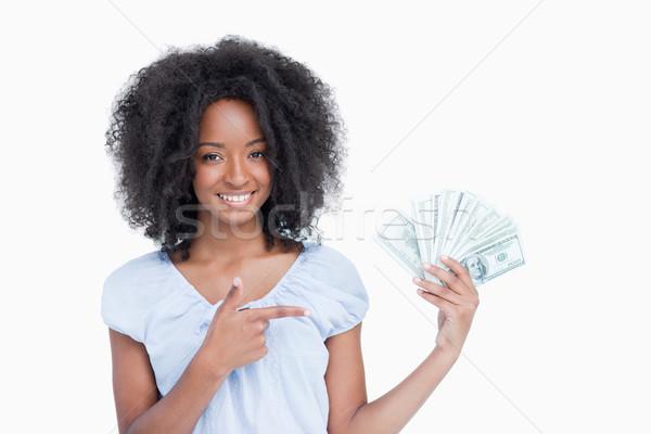 Jóvenes mujer sonriente pelo rizado senalando dedo ventilador Foto stock © wavebreak_media