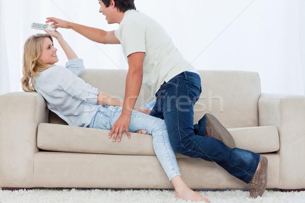 человека диване телевидение пультом подруга Сток-фото © wavebreak_media