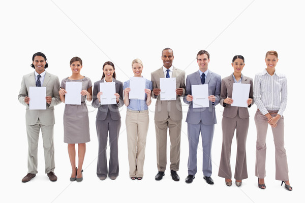Happy business people holding seven white supports for letters against white background Stock photo © wavebreak_media