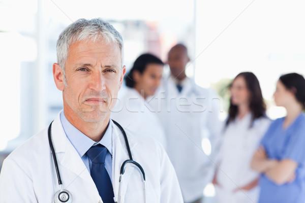 Maduro médico olhando em linha reta à frente sério Foto stock © wavebreak_media