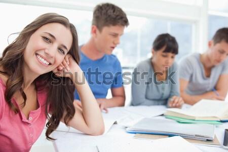 Vue de côté coup élèves regarder caméra souriant Photo stock © wavebreak_media