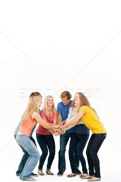 Gruppe Freunde jubeln Hände gestapelt lächelnd Stock foto © wavebreak_media