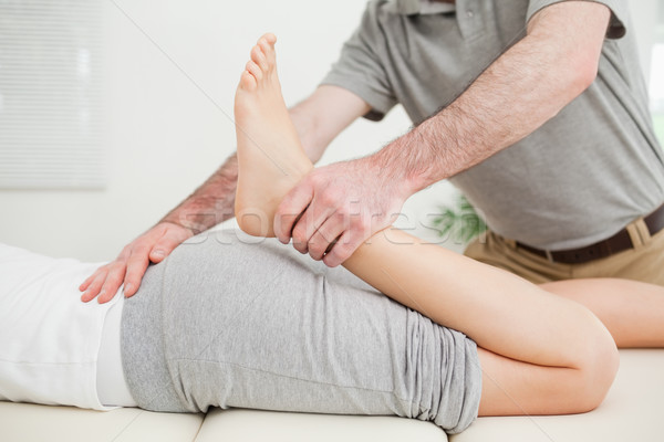 Close-up of a woman lying while being stretched in a room Stock photo © wavebreak_media