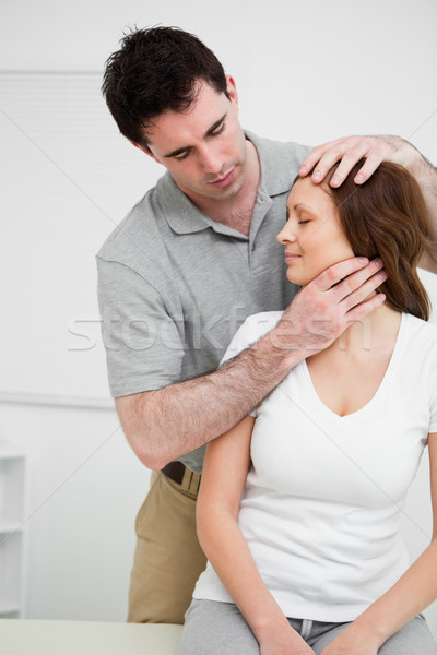 Osteopath insuring central alignment of spine in a medical room Stock photo © wavebreak_media