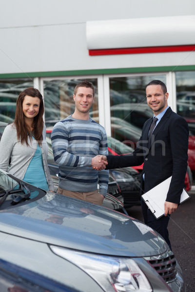 Client shaking the hand of a man in a dealership Stock photo © wavebreak_media
