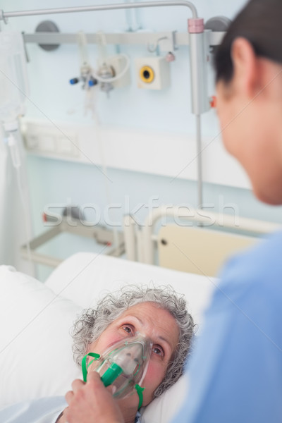 Patient having an oxygen mask on her face in hospital ward Stock photo © wavebreak_media