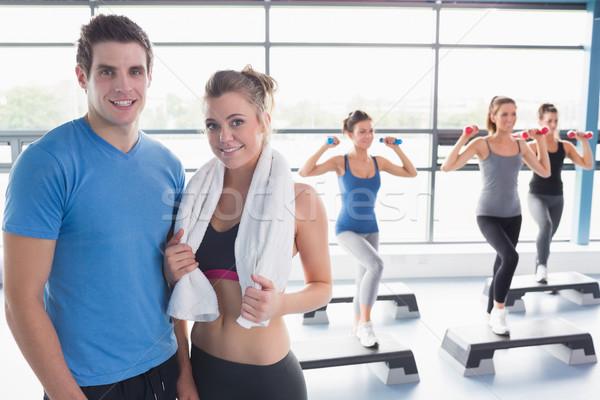 Frau Ausbilder lächelnd Aerobic Klasse Fitnessstudio Stock foto © wavebreak_media
