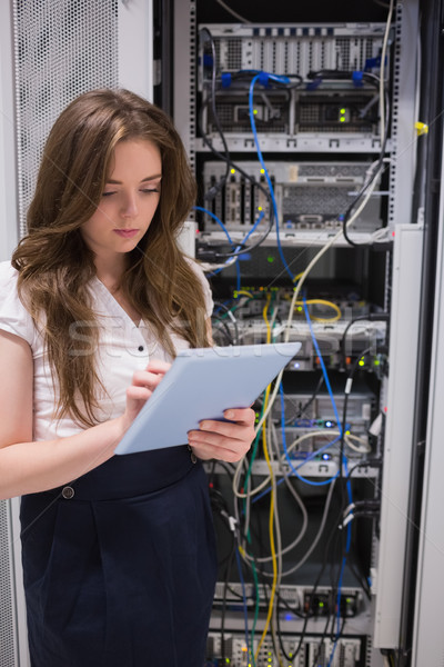 Woman checking servers using tablet pc in data center Stock photo © wavebreak_media