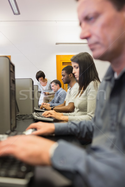 Woman helping her student with the computer in computer class Stock photo © wavebreak_media