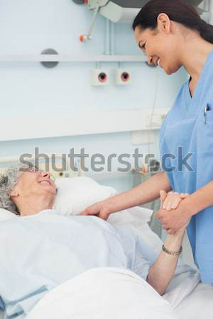 Obstetrician talking to a smiling pregnant patient Stock photo © wavebreak_media