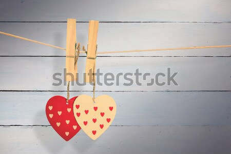 Two heart ornaments hanging from pegs on a line Stock photo © wavebreak_media