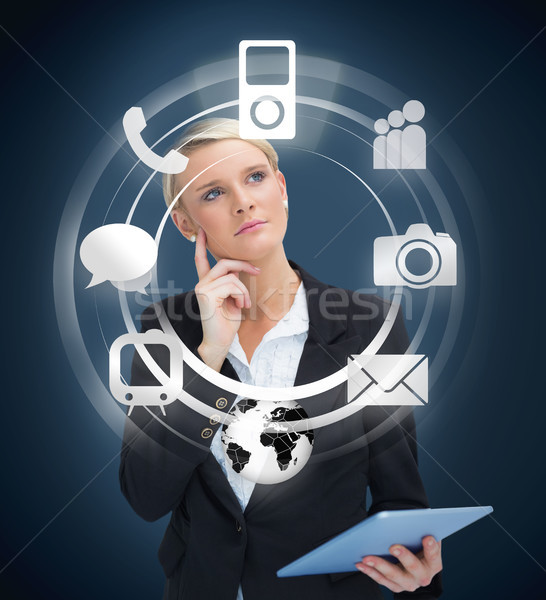 Thoughtful businesswoman with tablet pc considering various appl Stock photo © wavebreak_media