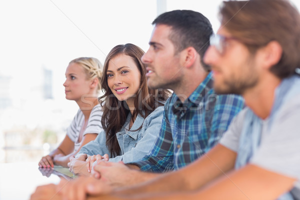 Criador equipe sessão linha uma mulher sorridente Foto stock © wavebreak_media