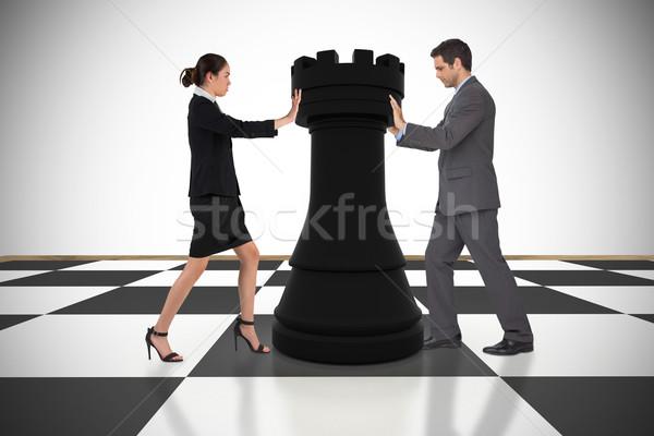 Composite image of business people pushing chess piece Stock photo © wavebreak_media