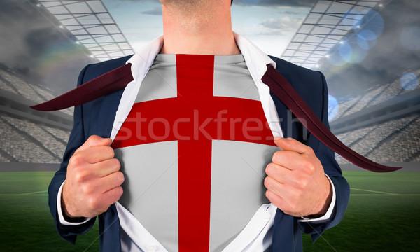 Businessman opening shirt to reveal england flag Stock photo © wavebreak_media