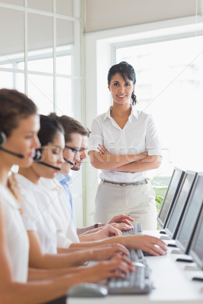 Female manager working in a call center Stock photo © wavebreak_media