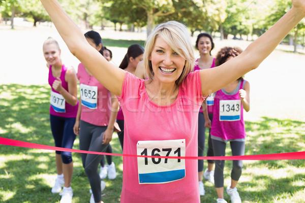 Happy winner of breast cancer marathon race Stock photo © wavebreak_media