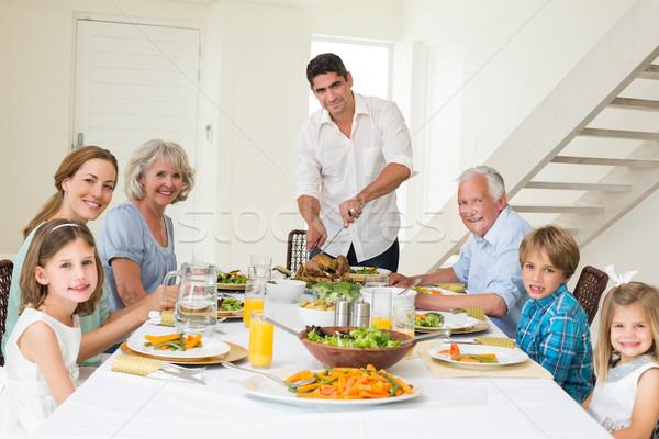 Sorridente pai refeição retrato de família família Foto stock © wavebreak_media