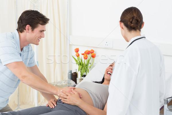 Médico feliz expectante casal feminino hospital Foto stock © wavebreak_media