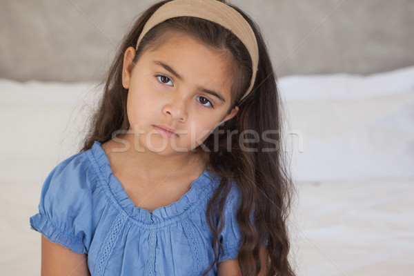 Close-up portrait of a sad young girl on bed Stock photo © wavebreak_media