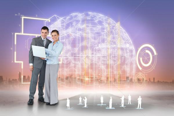 Boldog üzleti csapat laptopot használ interfész digitális kompozit üzletember Stock fotó © wavebreak_media