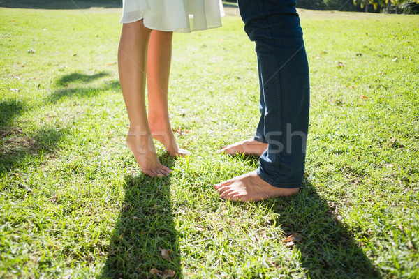 Couples bare feet standing on grass Stock photo © wavebreak_media