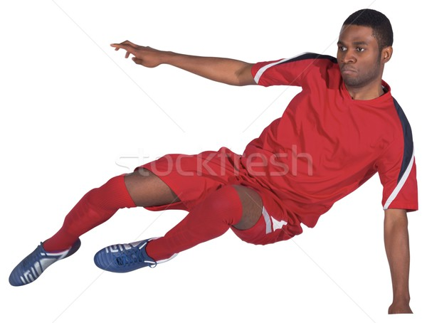 Football player in red kicking Stock photo © wavebreak_media