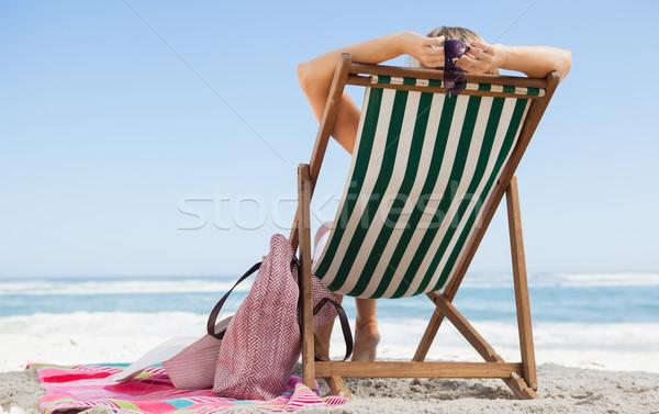 女性 座って デッキ 椅子 ビーチ ストックフォト © wavebreak_media