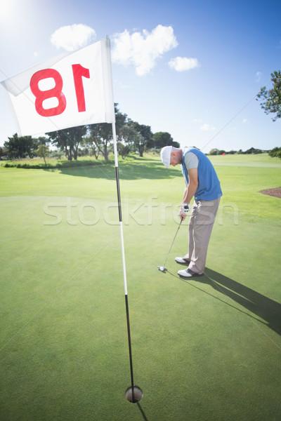 Jogador de golfe bola verde buraco campo de golfe Foto stock © wavebreak_media