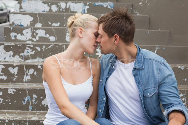 Hip young couple sitting on steps kissing Stock photo © wavebreak_media