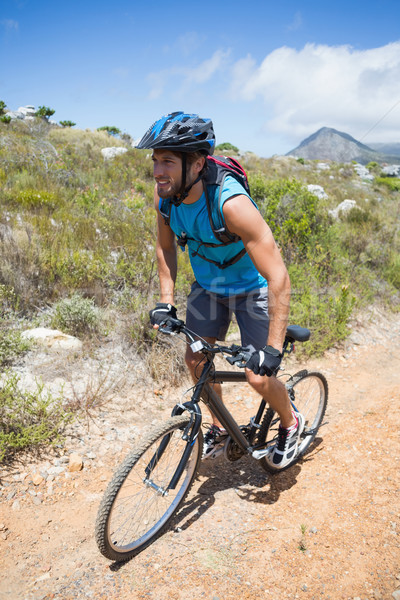 Fit man cycling up mountain trail Stock photo © wavebreak_media