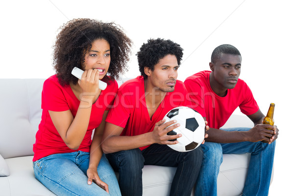 Nervoso futebol fãs vermelho sessão sofá Foto stock © wavebreak_media
